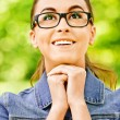 Smiling dark-haired woman in glasses — Stock Photo