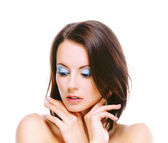 Dark-haired woman with bared shoulders — Stock Photo