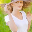 Young woman in magnificent hat — Stock Photo