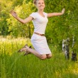 Womjumps upwards and laughs — Stock Photo #5909561