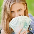 Woman with Russian roubles - Stock Photo