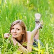 Young woman lies on green grass — Stock Photo #5909575