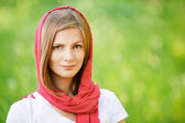 Woman in red headscarf smiles — Stock Photo