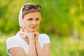 Woman in headscarf with sunshades — Stock Photo