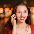 Woman talks on cellular telephone — Stock Photo