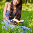 Portrait of beautiful young long-haired woman with book — Foto Stock