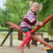 Portrait of a little blond girl on seesaw — Stock Photo