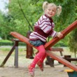 Stock Photo: Portrait of a little blond girl on seesaw