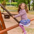 Stock Photo: Portrait of little girl having fun on seesaw