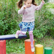 Little cute girl on playground - Stock Photo
