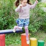 Little cute girl on playground — Stock Photo