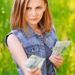 Portrait of strict woman with money - Stock Photo