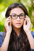 Portrait of beautiful young long-haired woman in eyeglasses — Stock Photo