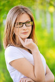 Portrait of beautiful young blond woman in eyeglasses — Stock Photo