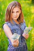 Portrait of strict woman with money — Stock Photo