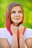 Portrait of young woman in red shawl — Stock Photo
