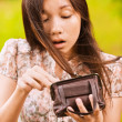 Yong woman looking in her little bag — Stock Photo
