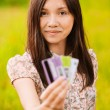 Portrait of young woman holding credit cards — Stock Photo