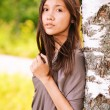 Portrait of young dreamy woman - Stockfoto