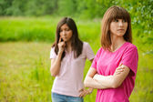 Two beautiful young women in park — Stock Photo