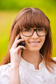Portrait of young lady with phone — Stock Photo