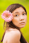Portrait of girl with flower in hair — Stock Photo