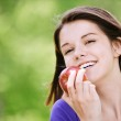 Portrait of attractive girl eating apple — Stock Photo