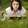 Young beautiful grand woman reading book — Stock Photo #6068584
