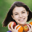 Young merry woman holding fruits — Stock Photo #6068586