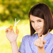 Portrait of young woman with scissors - Stockfoto
