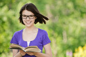 Young beautiful woman with book — Stock Photo