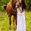 Stock Photo: Young womwith horse