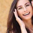 Young laughing woman wearing eyeglasses — Stock Photo
