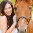 Portrait of young smiling woman with horse — Stock Photo