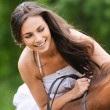 Young brunette woman rides a horse — Stock Photo #6084847