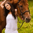 Young beautiful woman with horse - Stock Photo