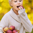Royalty-Free Stock Photo: Portrait of young pretty woman eating apples