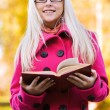 Smart blond woman with book — Stockfoto