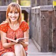 Young smiling woman with book — Stock Photo #6126972