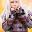 Young appealing blond womat autumn park — Stock Photo #6126976
