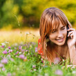 Young woman speaking on phone — Stock Photo #6126981