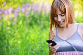 Young beautiful woman with telephone — Stock Photo