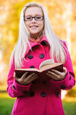 Smart blond woman with book — Stock Photo