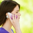 Portrait of young woman speaking on mobile telephone — Stock Photo