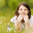 Teen girl lying on grass — Stock Photo #6142949