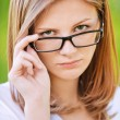 Portrait of strict woman looking above her glasses — Stock Photo #6145544