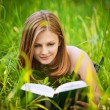 Portrait of young woman reading a book - Foto de Stock