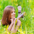 Young womlying in grass — Stock Photo #6145593