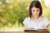 Portrait of beautiful reading brunette girl — Stock Photo