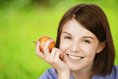 Portrait of young charming woman with apple — Stock Photo